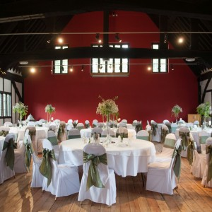 Tables decorated for a wedding inside historic building