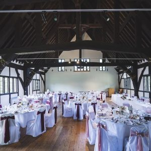 Dining tables decorated for a wedding in a historic building