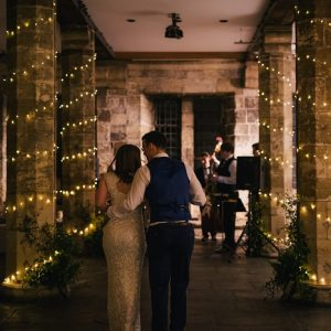 Bride and groom dancing inside historic venue