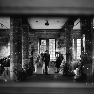Black and white photo of interior wedding scene